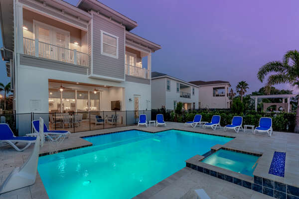 Hangout by the pool day or night and enjoy the sun loungers and spillover spa