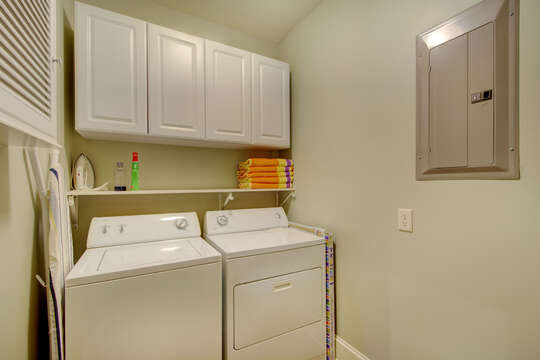 Picture of the laundry room, with washer, dryer, and cabinetry.