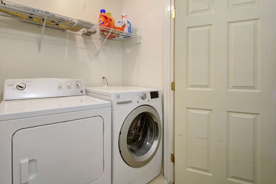 Washer and dryer in laundry space upstairs.