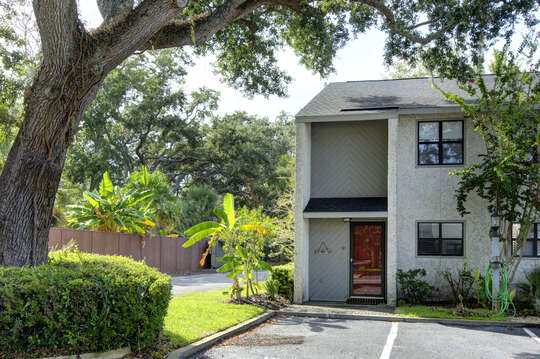 The front exterior of this accommodation in St. Simons Island GA, with parking spot in front.