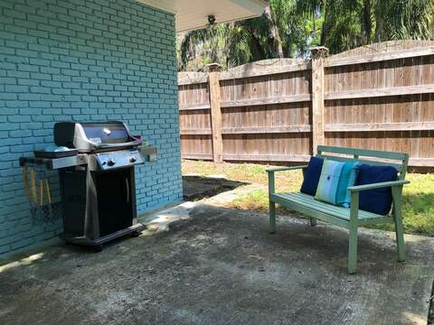 Barbecue Grill and Bench on the Patio