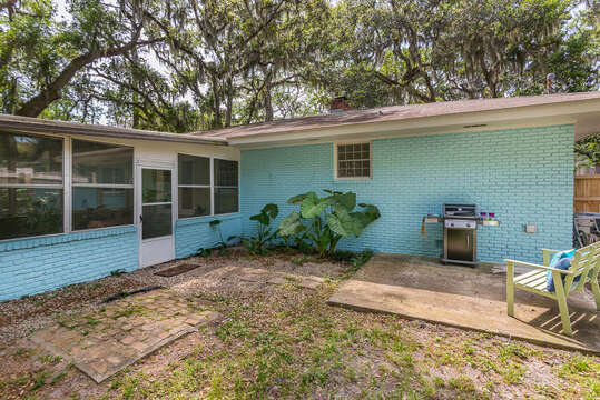 Rear of Home and Backyard with Barbecue Grill