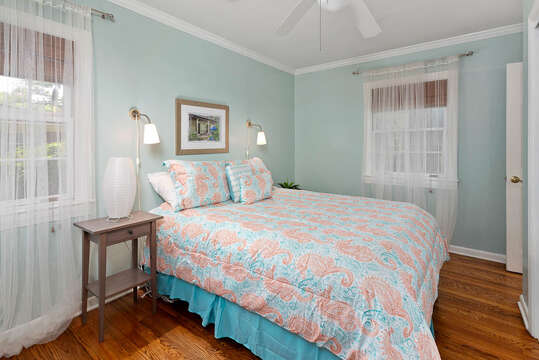 Second Bedroom with Warm Decor and Comfortable Bed