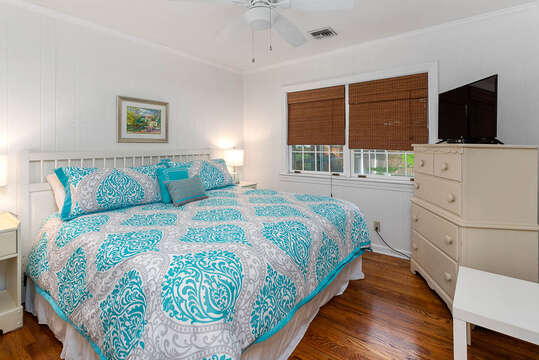 Master Bedroom with Large Bed, Dresser and Flat Screen TV