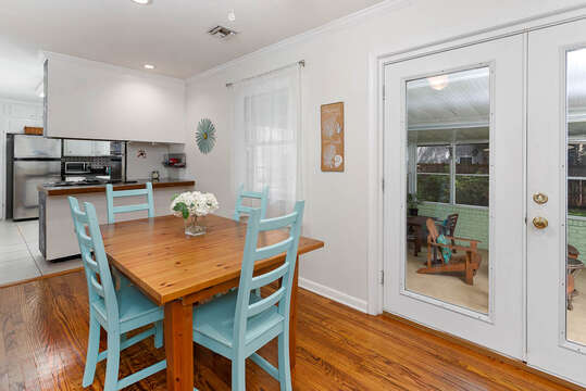 Small Dining Area and Door to Enclosed Patio
