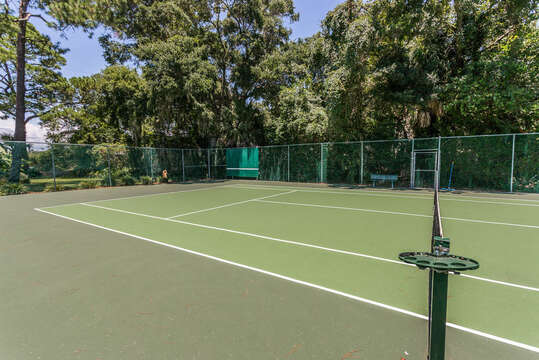 Tennis Court Surrounded by Trees.