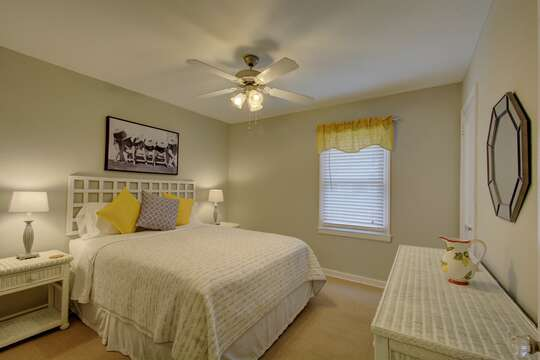 Enjoy a Spacious Bedroom with Yellow Accents.