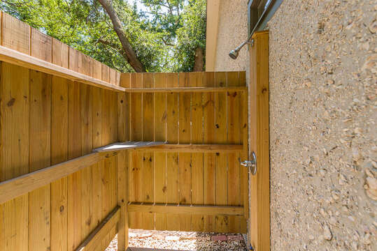 Wooden Fence Surrounds Vacation Rental.