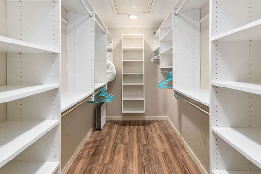 Large Walk-In Closet Includes Plenty of Shelves.