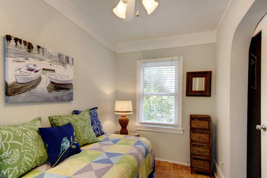 Bedroom Includes Large Window and Artwork.