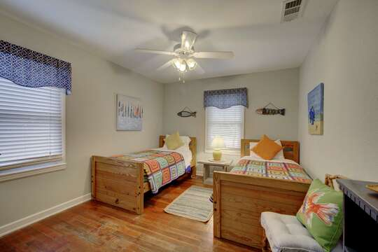 Large Bedroom Includes Two Beds and Windows.