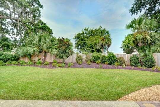 Beautifully Manicured Lawn in Backyard.
