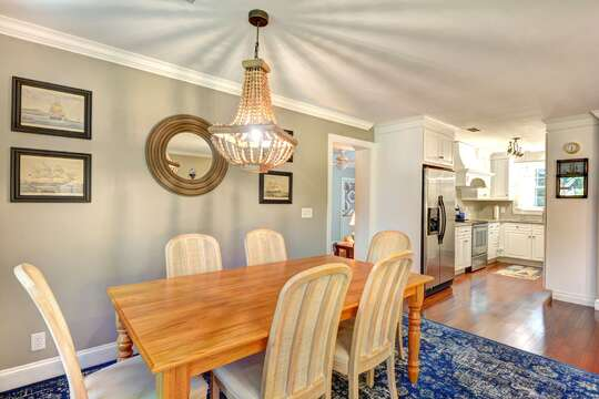 Wooden Dining Room Table Sits Up to 6 Guests.