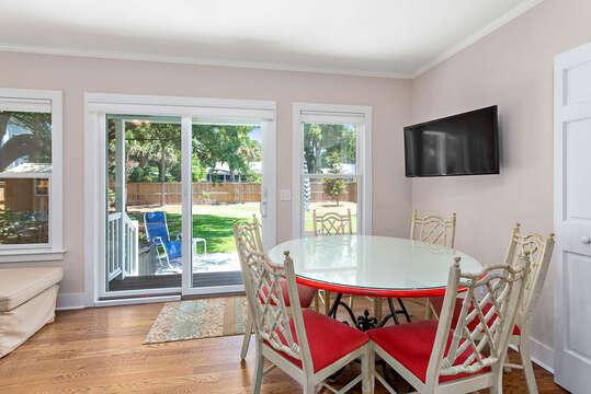 Dining area near sliding glass door to backyard