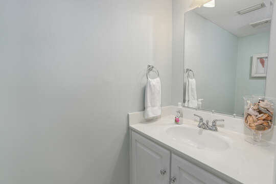 Bathroom with sink and mirror.
