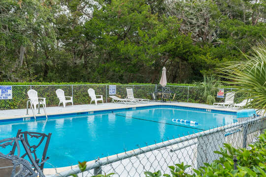 The pool and pool seating of this accommodation in St. Simons Island GA.