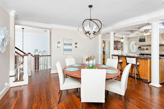Dining Area Features Large Table and Six Chairs.