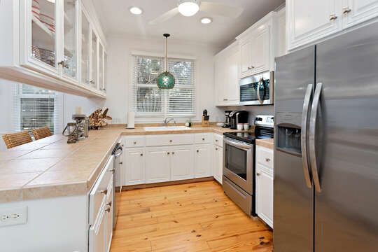 Coastal Kitchen with Stainless Steel Appliances