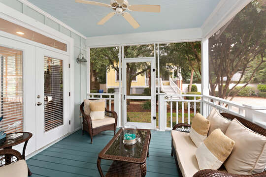 Great Screened Porch with a ceiling fan and plenty of seating off of the living room and master bedroom