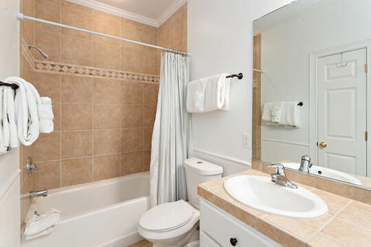 Master Bathroom with shower/tub combo and white walls