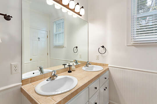 Master Bathroom with a double sink vanity and white walls