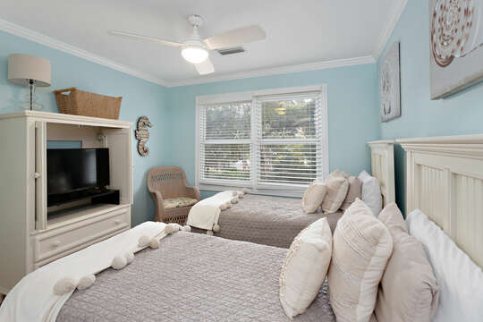 Upstairs Guest Bedroom with two twin beds and an HD TV