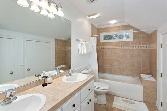 Upstairs Guest Hall Bathroom with tub/shower and a double vanity
