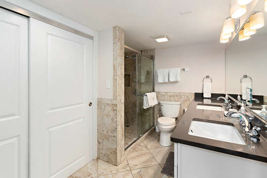 Master Bathroom with a double vanity and a walk-in shower