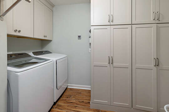 Large Laundry room with new washer and dryer