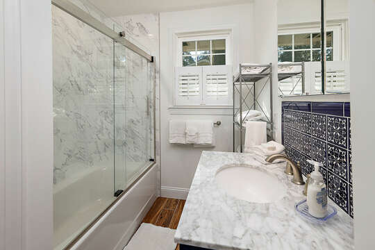 Completely remodeled guest hall bath with a tub/shower