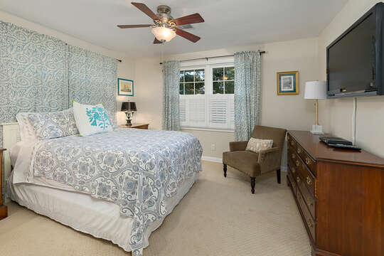 Spacious Bedroom Features a Large Bed and Many Windows.
