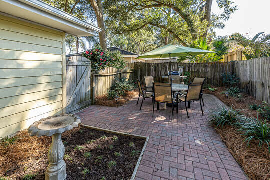 Backyard with Table and Chairs for Six and a Weber gas grill