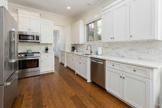 The kitchen featuring a stainless steel refrigerator, gas range and dishwasher