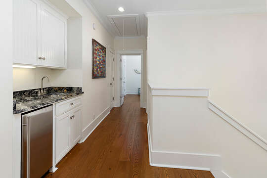 Upstairs hallway with wet bar