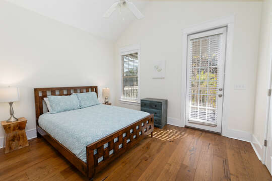 Guest bedroom with Queen Bed and access to the front second floor balcony