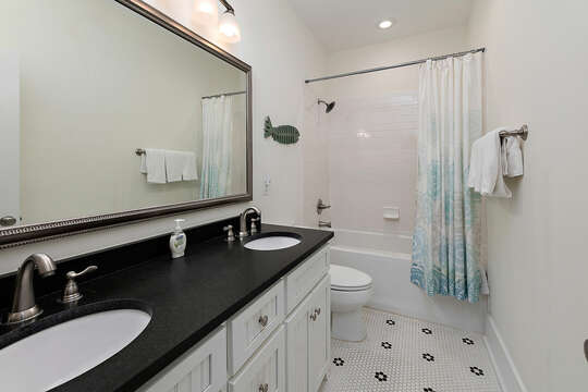 Bathroom with shower/tub combo and a double vanity