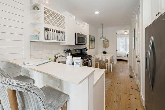 Kitchen with stainless steel range, dishwasher and refrigerator