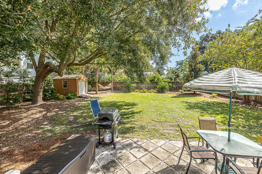 Backyard space with dining area, grill and tons of yard space