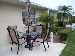 Patio area with seating for 4.