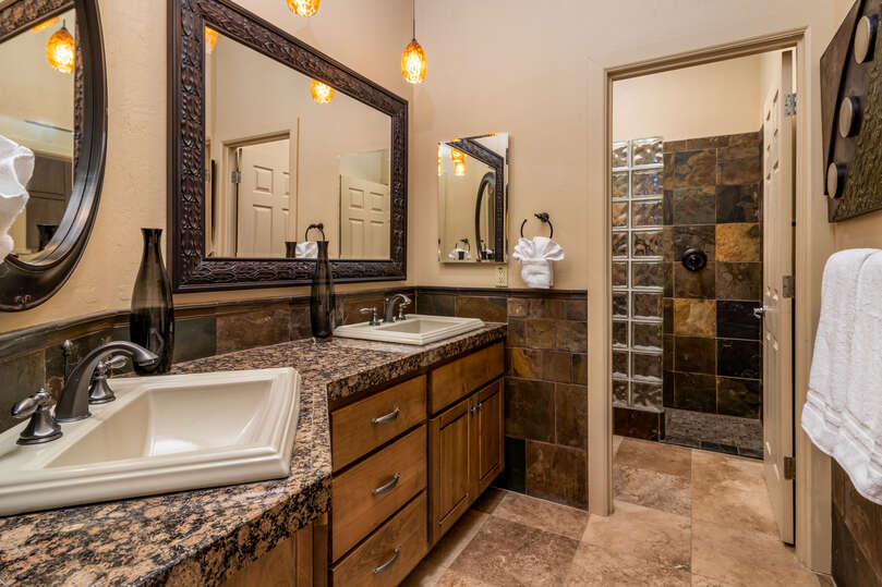 Bathroom with walk in shower and two sinks