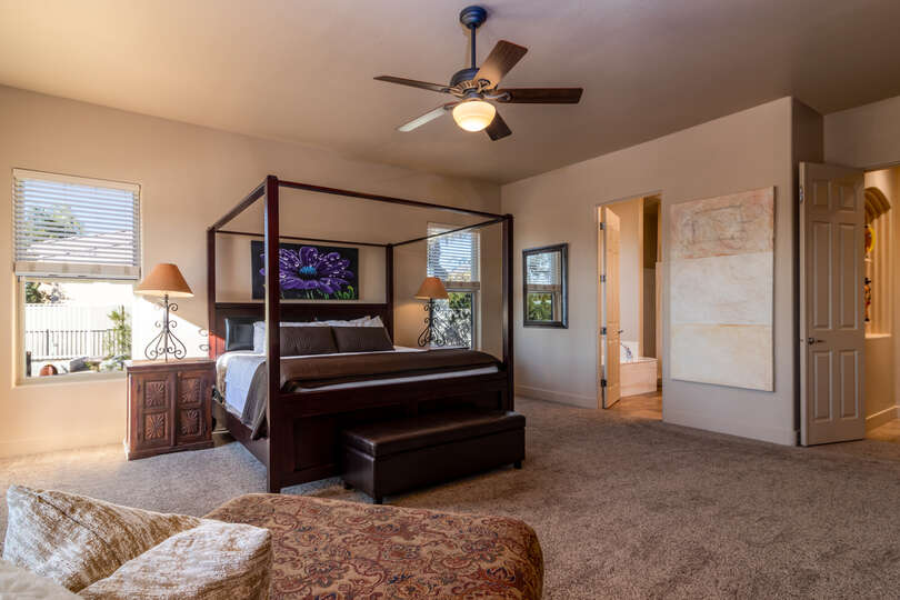 Bedroom with nearby nightstand and bathroom