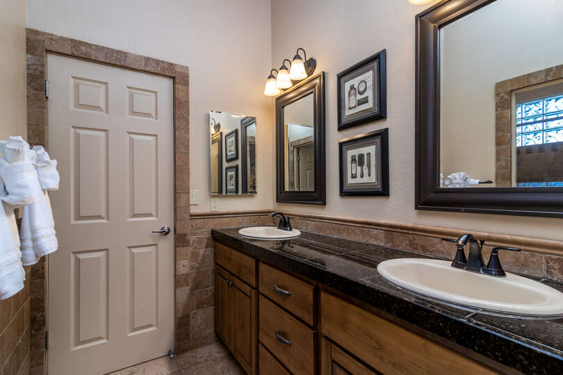 Bathroom sinks with three mirror and overhead lighting