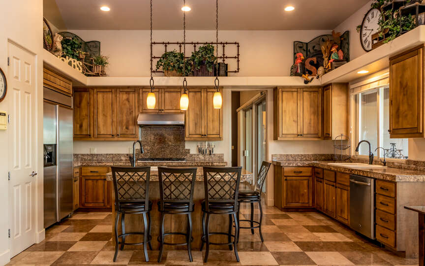 Kitchen with island seating and two sinks