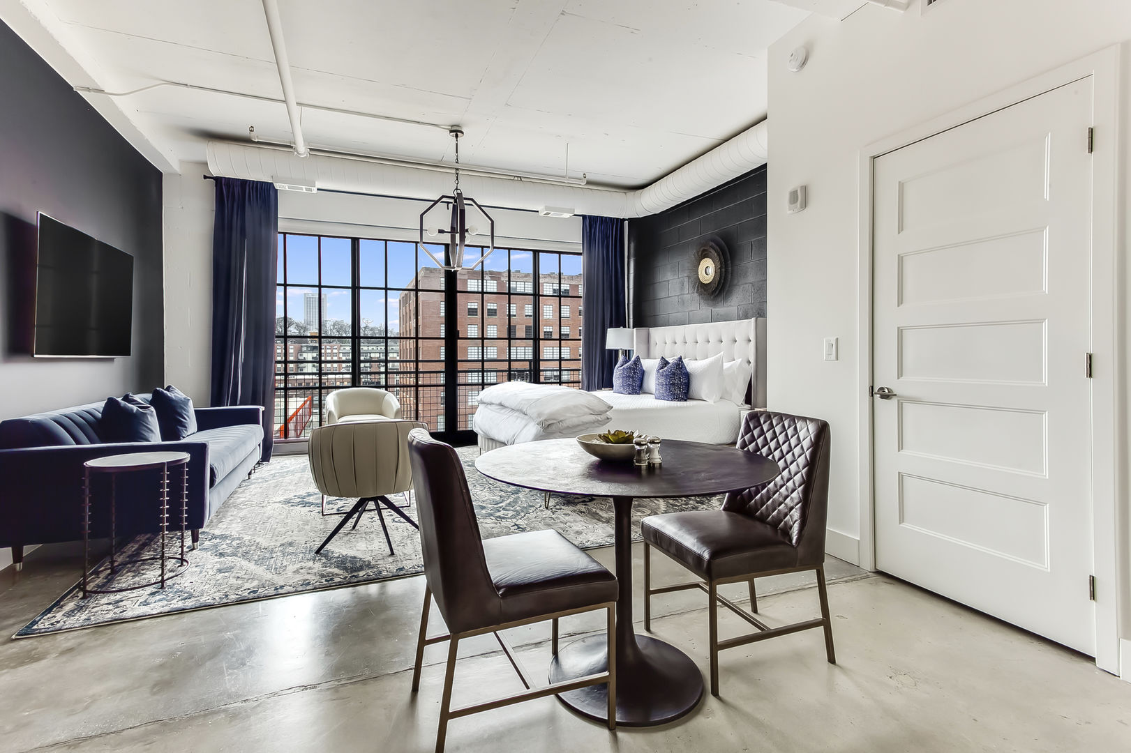 Dining Area for Two and Concrete Floors at Ponce City Market Apartment