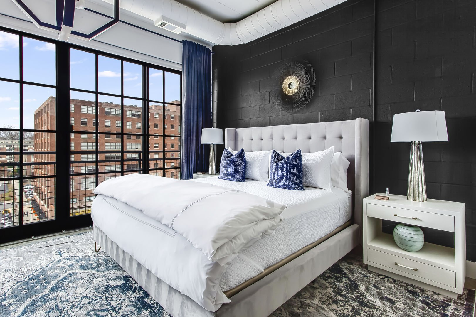 Sleeping area with Upscale Furniture in Ponce City Marketplace Apartment