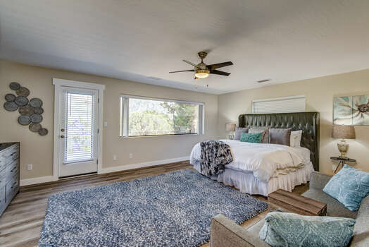 Upper Level Grand Master Bedroom with King Bed, a Big Picture Window and Deck Access