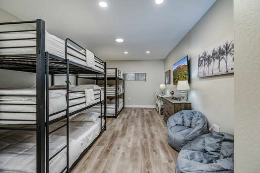 Lower Level Bunk Room with Two Sets of Triple Queen Bunk Beds, a 65