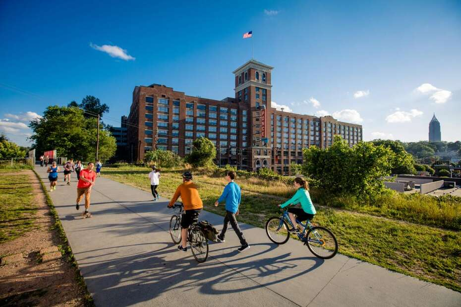 People walking and biking along Beltline ATL