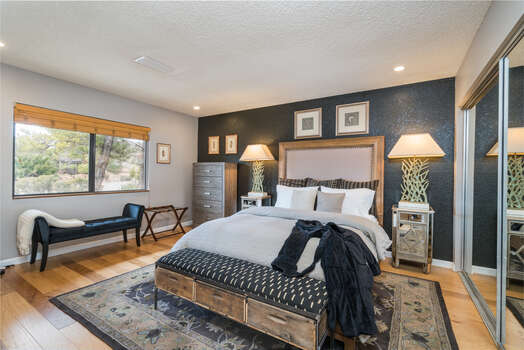 Hardwood Floors Continue to the Bedrooms - Master Bedroom with a Queen Bed