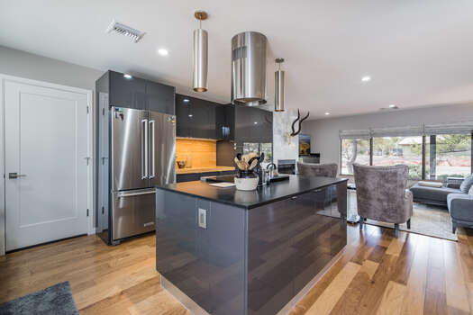 Fully Equipped Kitchen with Stainless Steel Appliances Including an Electric Range